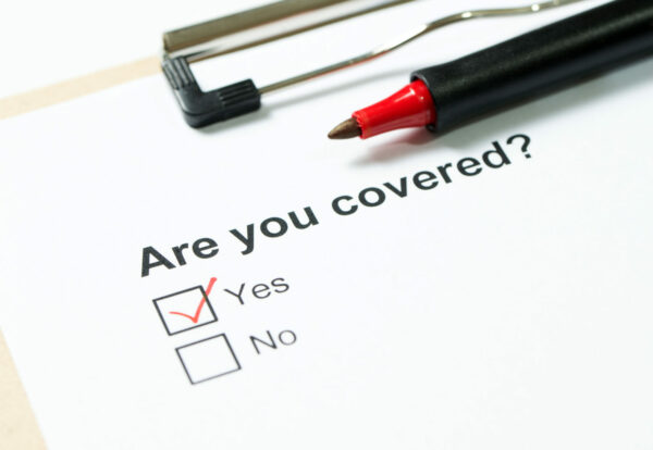 Are you covered questionnaire on clipboard with a red pen