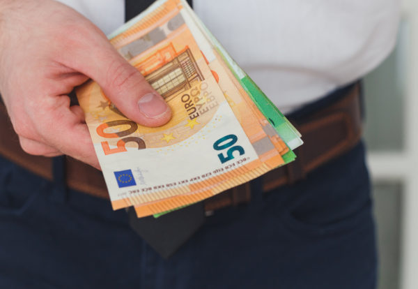 detail-of-man-hands-with-money-euro-notes-9F8ELNL_Easy-Resize.com_